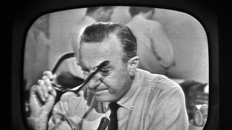 CBS News anchor Walter Cronkite reports that President