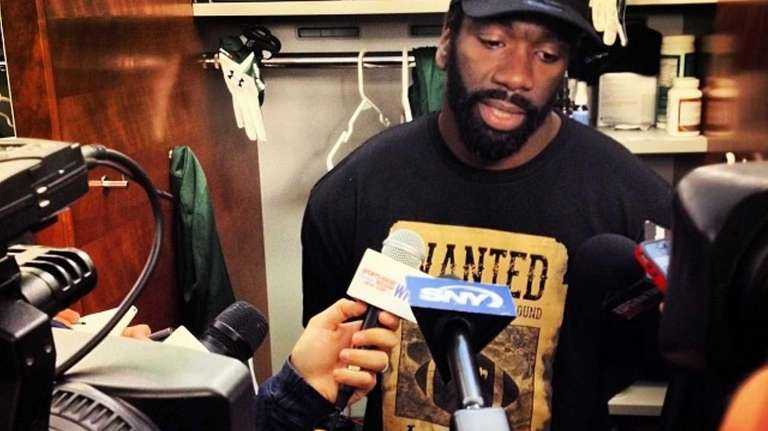 Jets safety Ed Reed speaks to reporters after