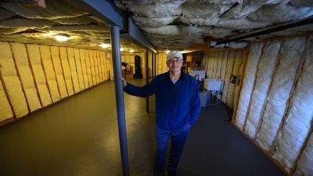 East Rockaway homeowner Howard Griesch photographed in his
