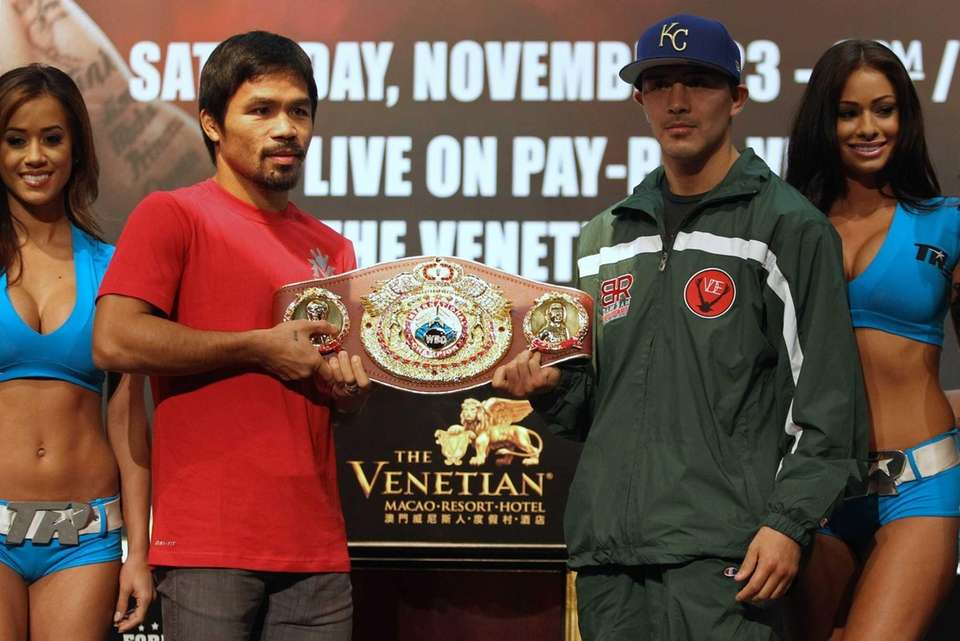 Philippine boxing icon Manny Pacquiao, left, and Brandon