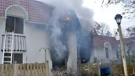Firefighters from at least nine Suffolk County fire