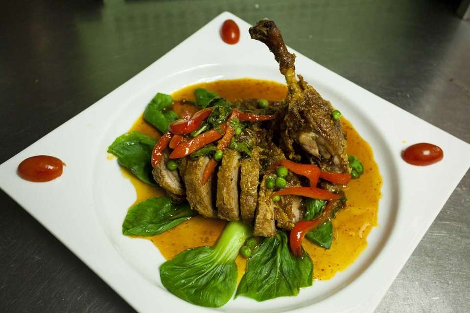 Bangkok Duck, crispy boneless duck topped with spicy