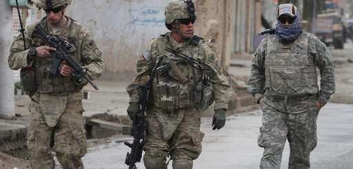 U.S. soldiers walk with their Afghan translator near