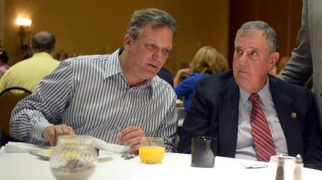Nassau County Executive Edward Mangano, left, speaks with
