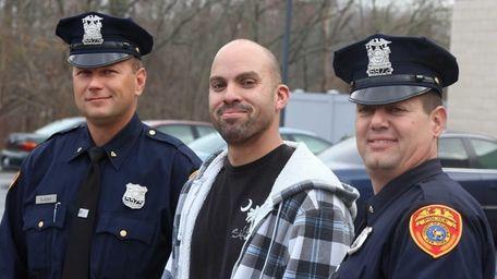 Suffolk County Police Officer David Vlacich, left, David