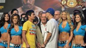 Filipino boxer Manny Pacquiao, left, and Brandon Rios
