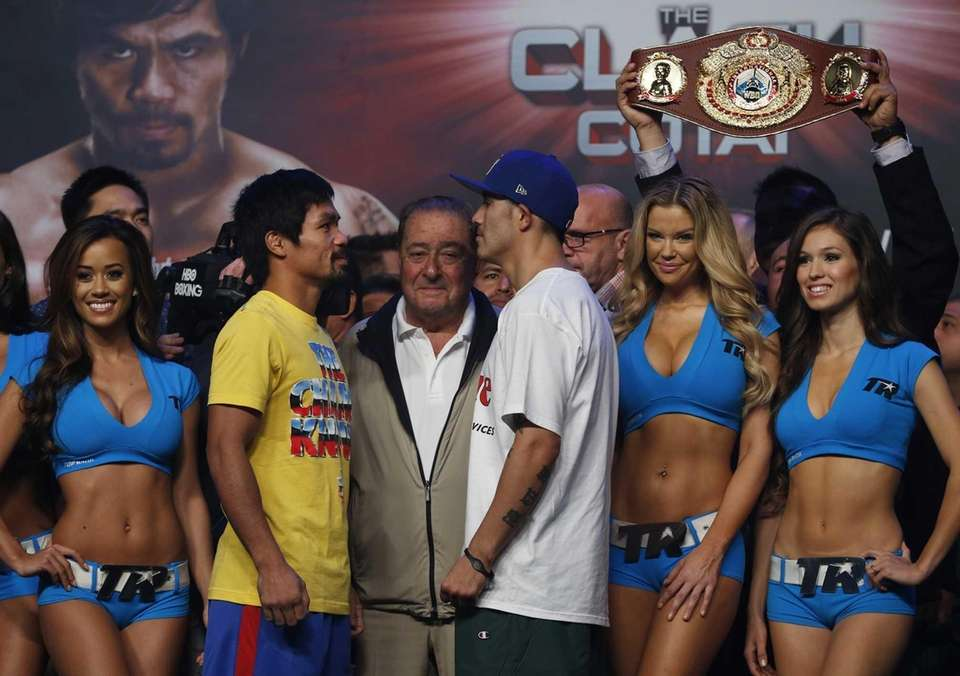 Filipino boxer Manny Pacquiao, center left, and Brandon