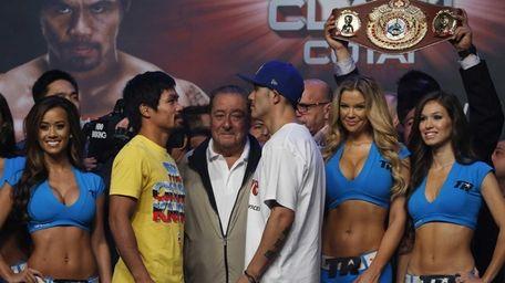 Filipino boxer Manny Pacquiao, center left, and Brandon