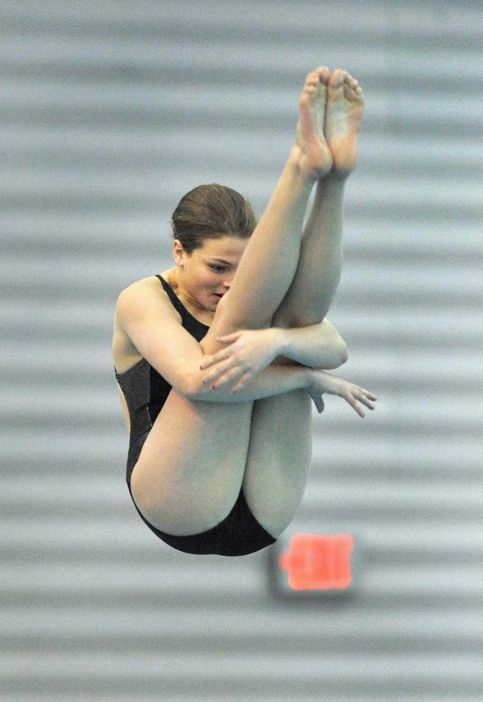 Sachem North's Rachel Heymach performs a dive during