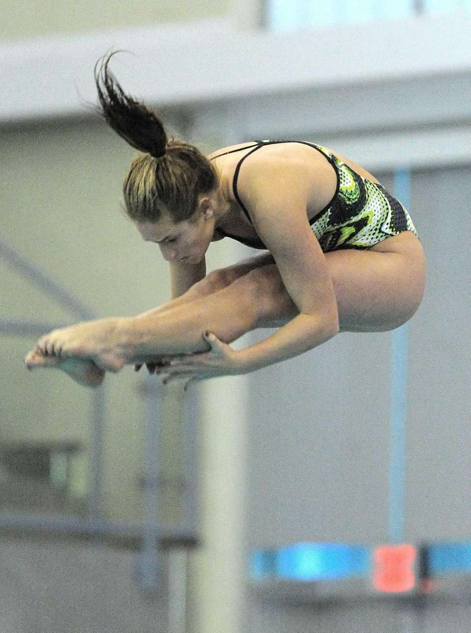 Long Beach's Emma Harris performs a dive during