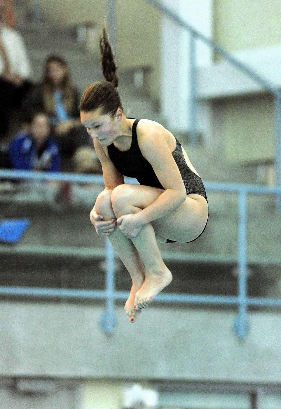 Lindenhurst's Grace Reeves performs a dive during the