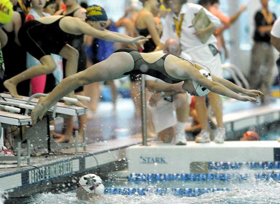 Ward Melville's Katie Wang, center, swims her leg