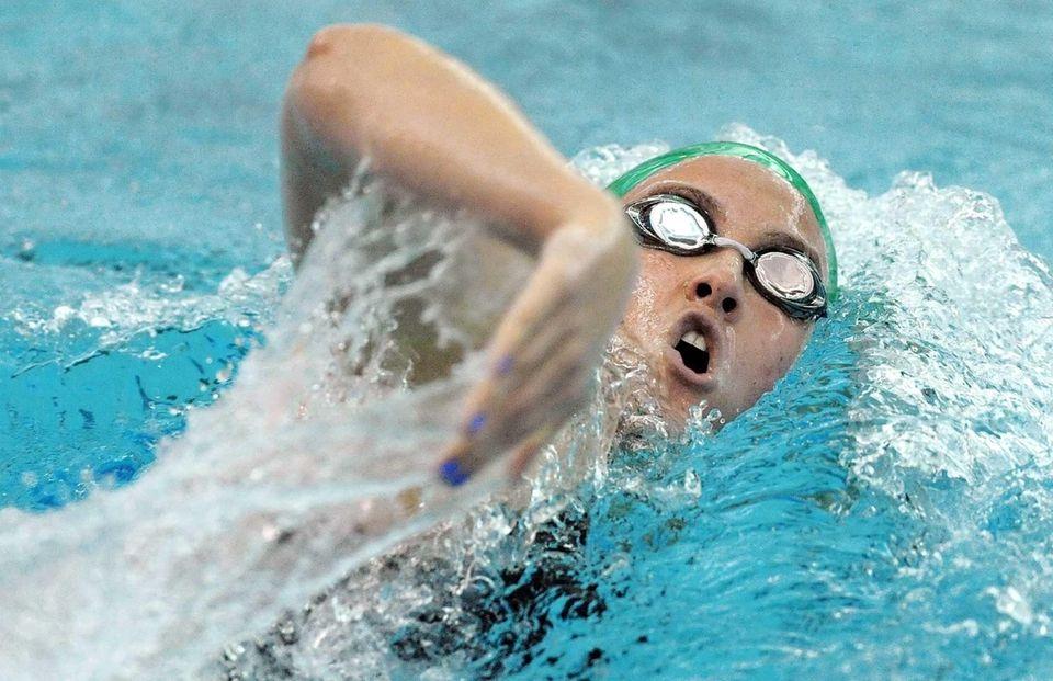 Massapequa's Molly Treble swims in a preliminary heat
