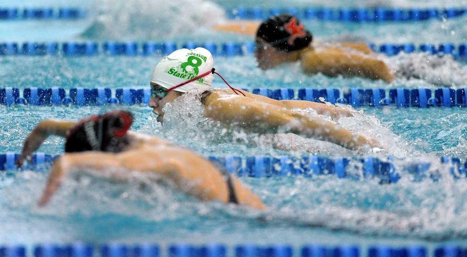 Bellmore-Merrick's Jessica Arana, center, swims in a preliminary