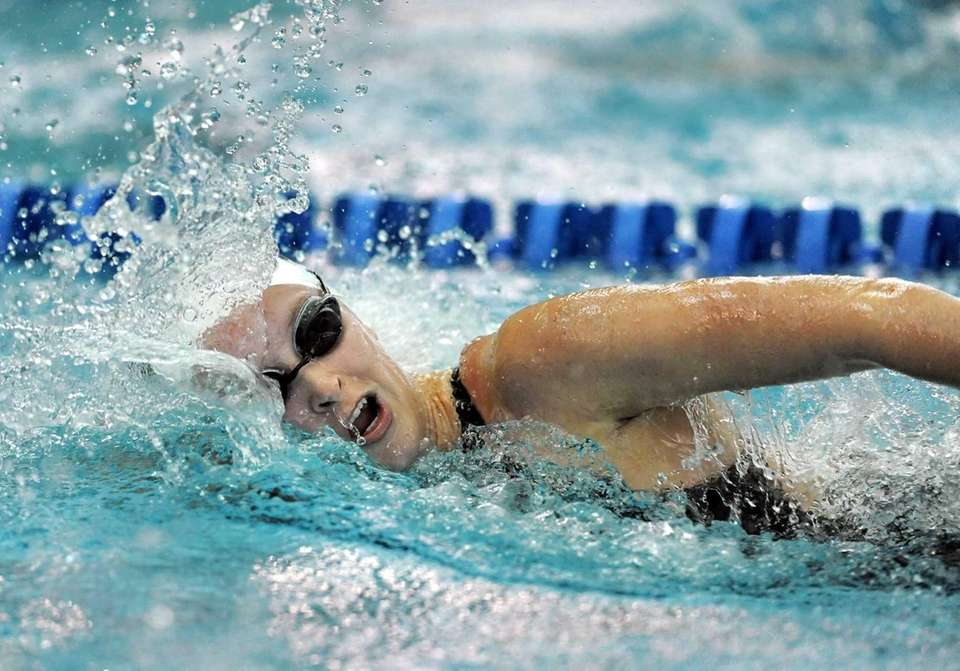Northport's Melanie Newton swims in a preliminary heat