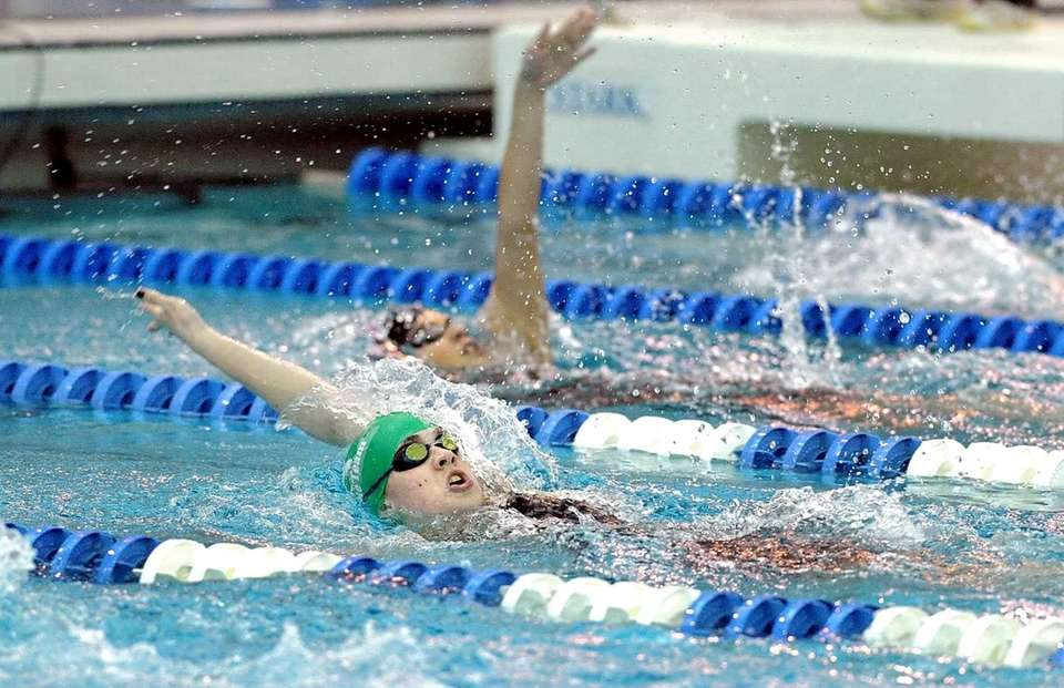 Manhasset's Kylie Mulholland, bottom, swims in a preliminary