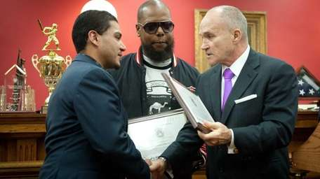 Police Commissioner Raymond Kelly recognized two good Samaritans,