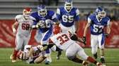 Riverhead's Jeremiah Cheatom runs the football against East