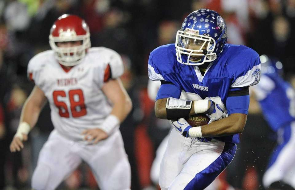Riverhead's Jeremiah Cheatom carries the ball against East