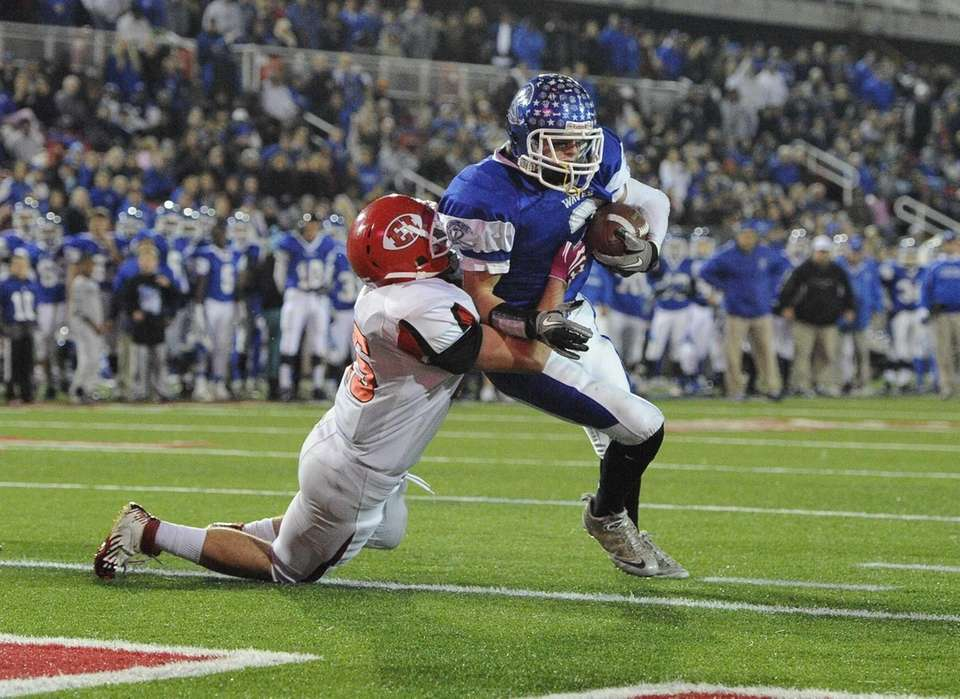 Riverhead's quarterback Cody Smith scores a touchdown as
