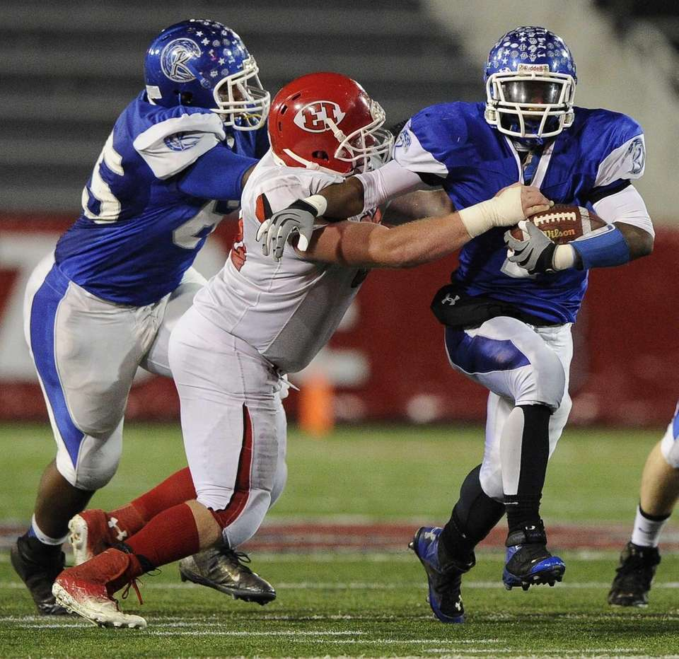 Riverhead's Ryun Moore is defended by East Islip's