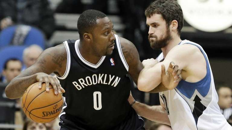 Nets' Andray Blatche, left, is defended by Minnesota