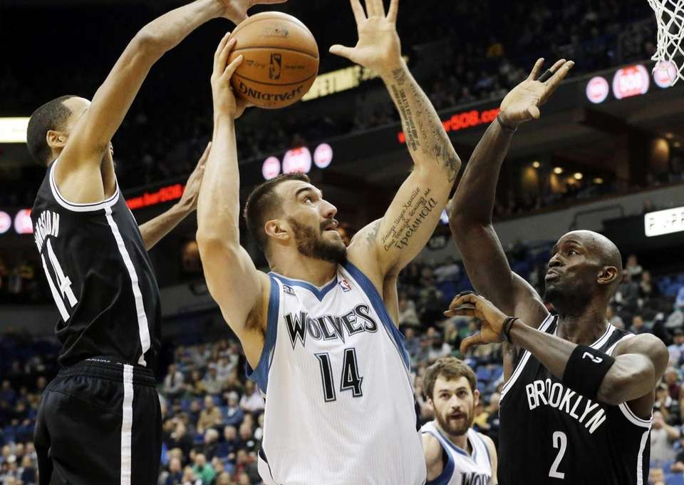 Minnesota Timberwolves' Nikola Pekovic, center, attempts a shot