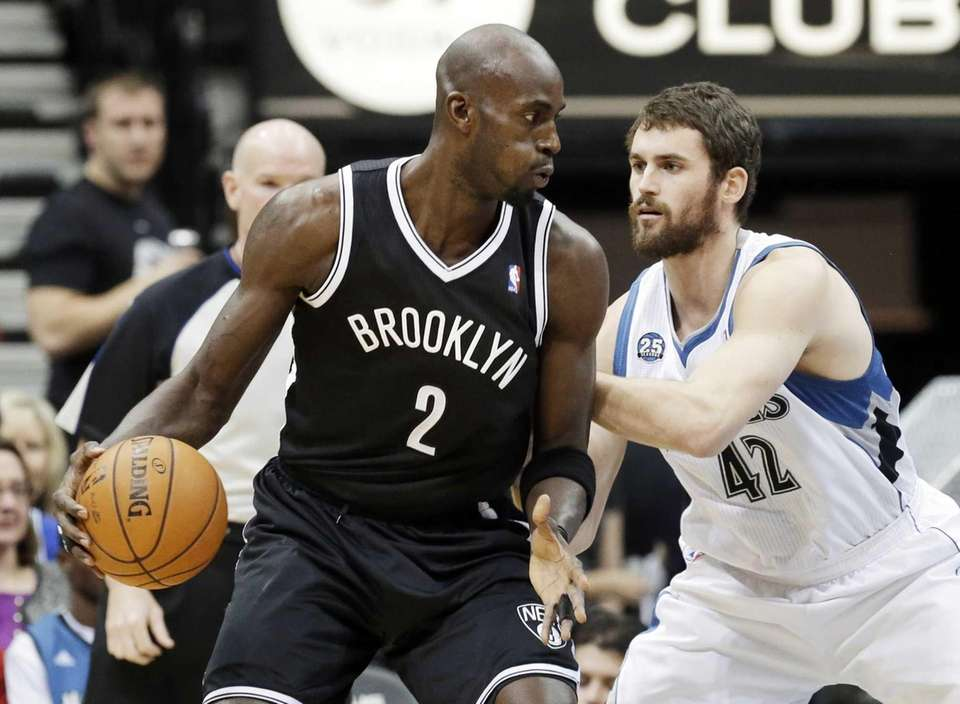 Nets' Kevin Garnett, left, drives around Minnesota Timberwolves'
