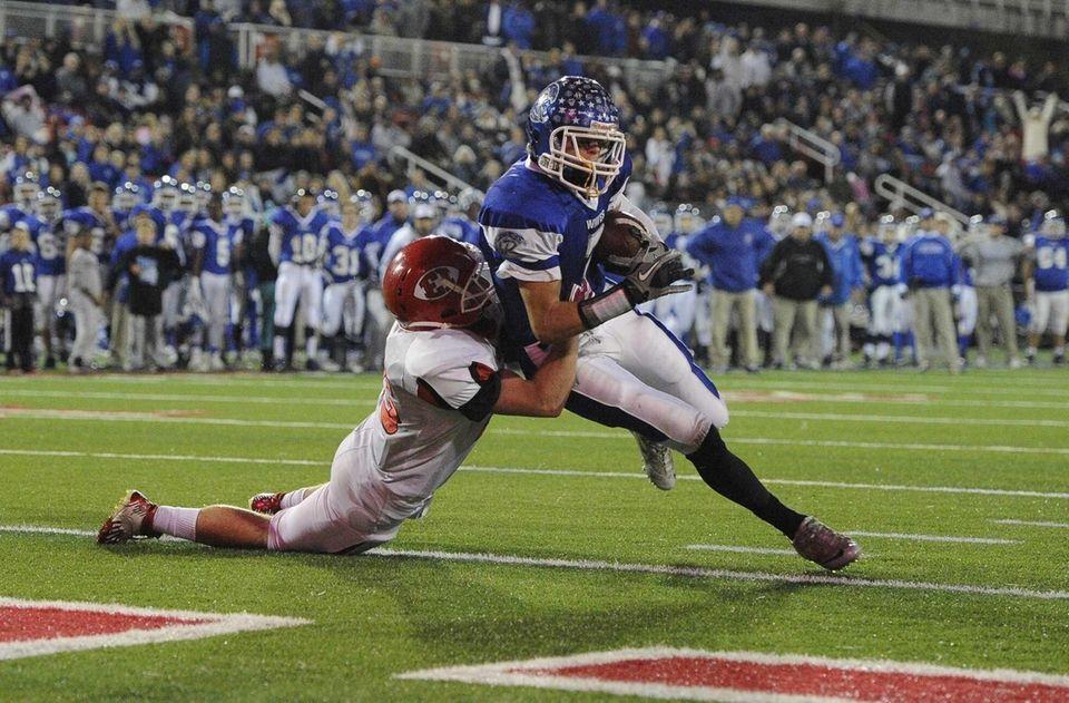 Riverhead's quarterback Cody Smith scores a touchdown as