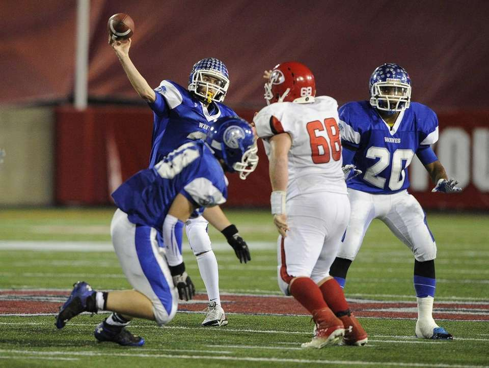 Riverhead quarterback Cody Smith passes the football against