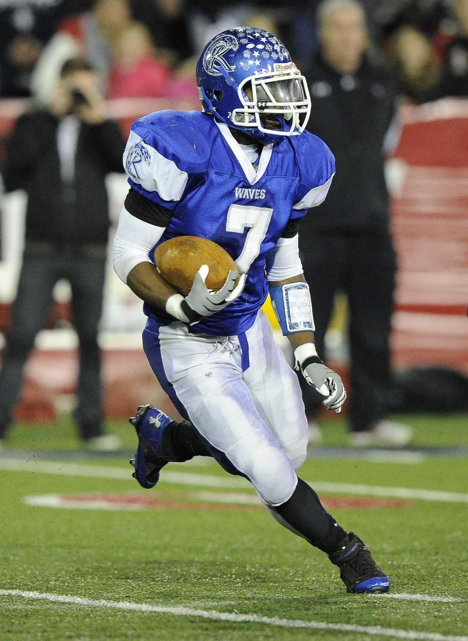Riverhead's Ryun Moore runs the football against East