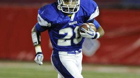 Riverhead's Jeremiah Cheatom carries the football against East