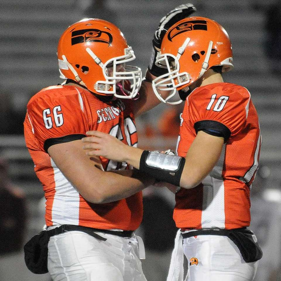 Carey quarterback Ray Catapano, right, gets congratulated by