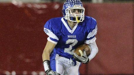 Riverhead's Ryan Hubbard carries the ball against East