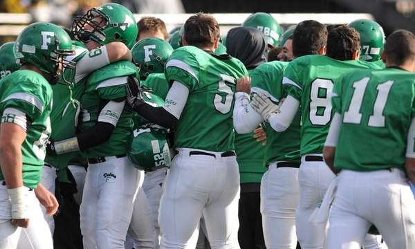 Farmingdale teammates celebrate after their 29-26 win over