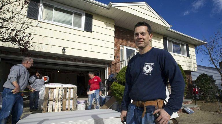 Freeport resident Bill Walsh, center, a New York