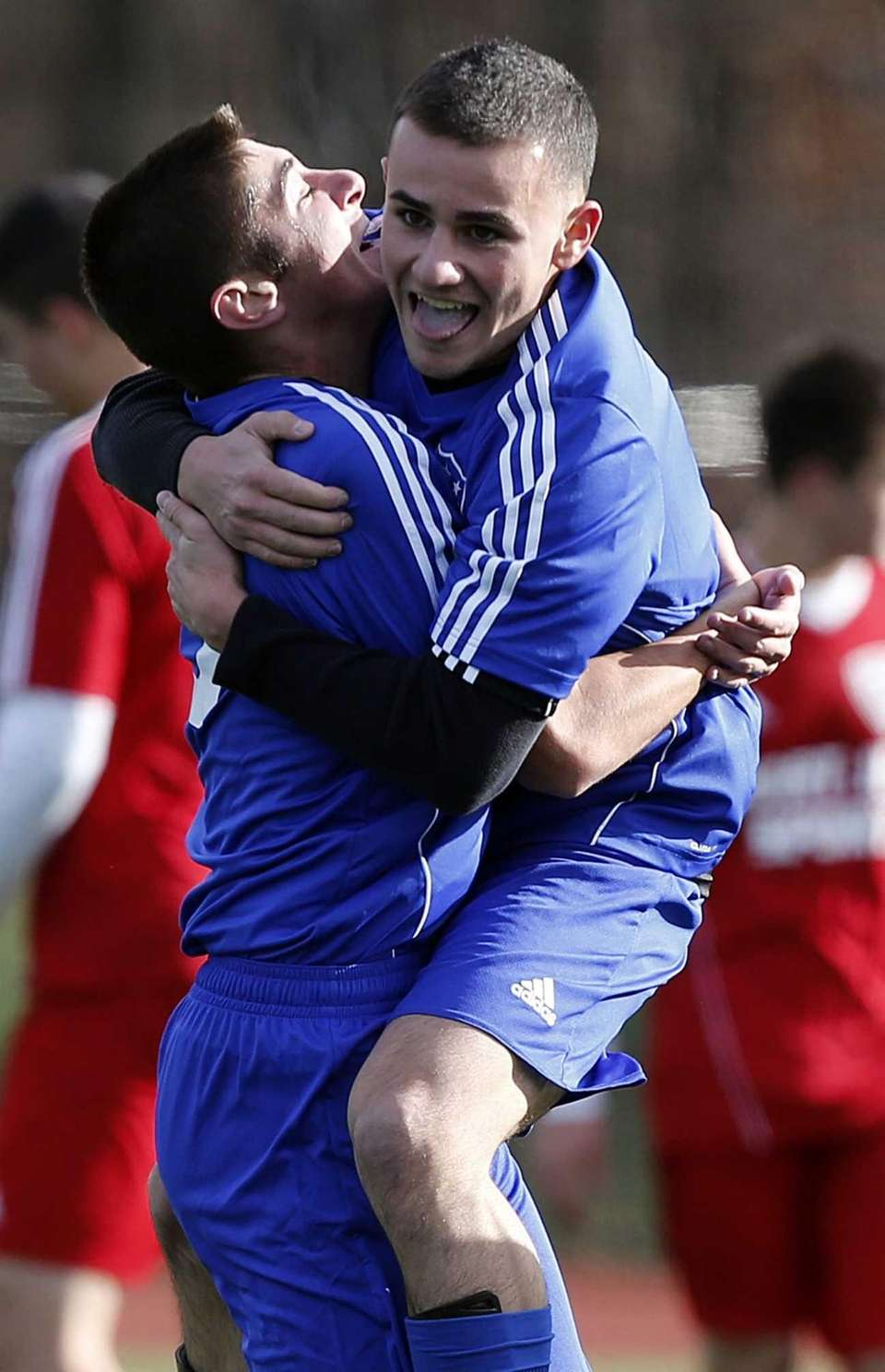 Nassau's Gino Dcardino is hugged by teammate Joe