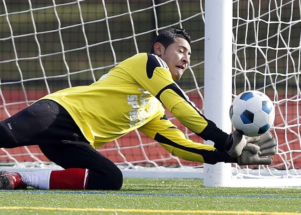 Suffolk keeper Alexis Batres deflects a shot during