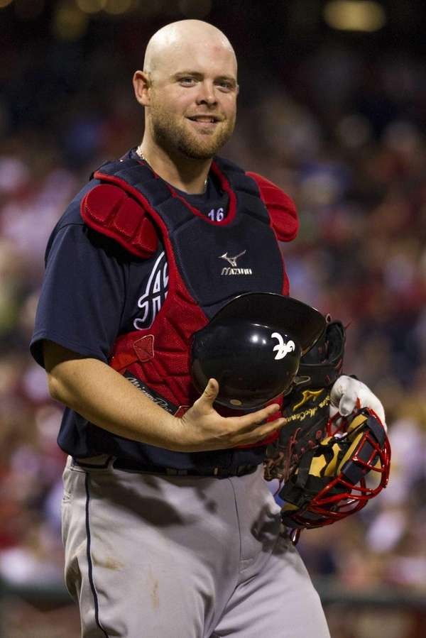 Atlanta Braves catcher Brian McCann looks to the