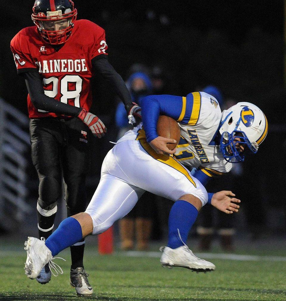 Lawrence quarterback Joe Capobianco (11) barrels past Plainedge