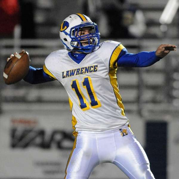 Lawrence quarterback Joe Capobianco completes a pass on