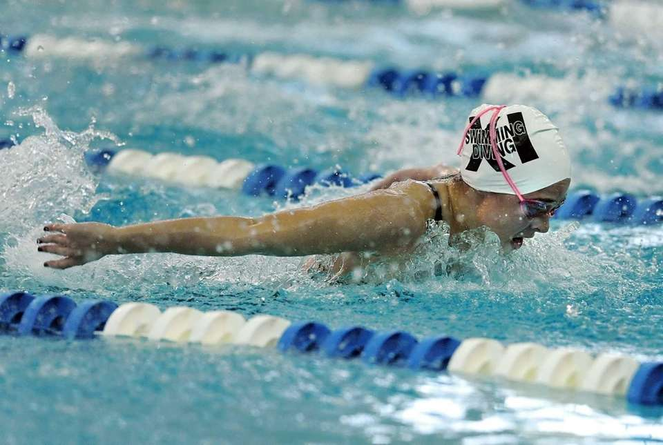 Smithtown's Jackie Dominger swims in the consolation finals