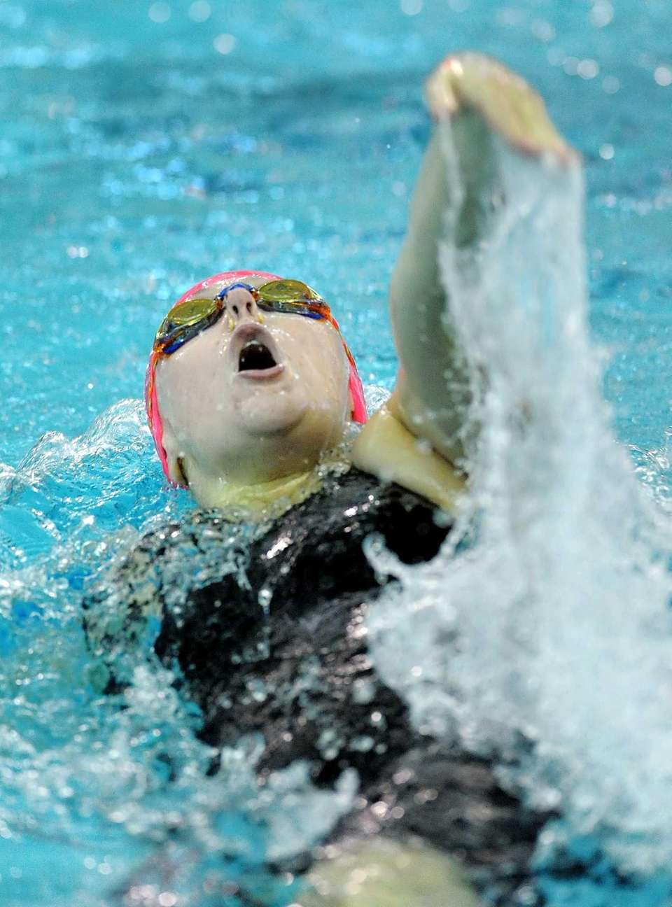St. Anthony's Kylie Danin swims in the consolation