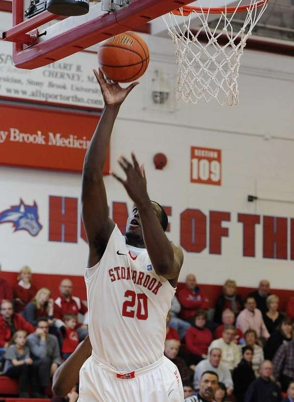 Stony Brook forward Jameel Warney shoots against Northeastern.