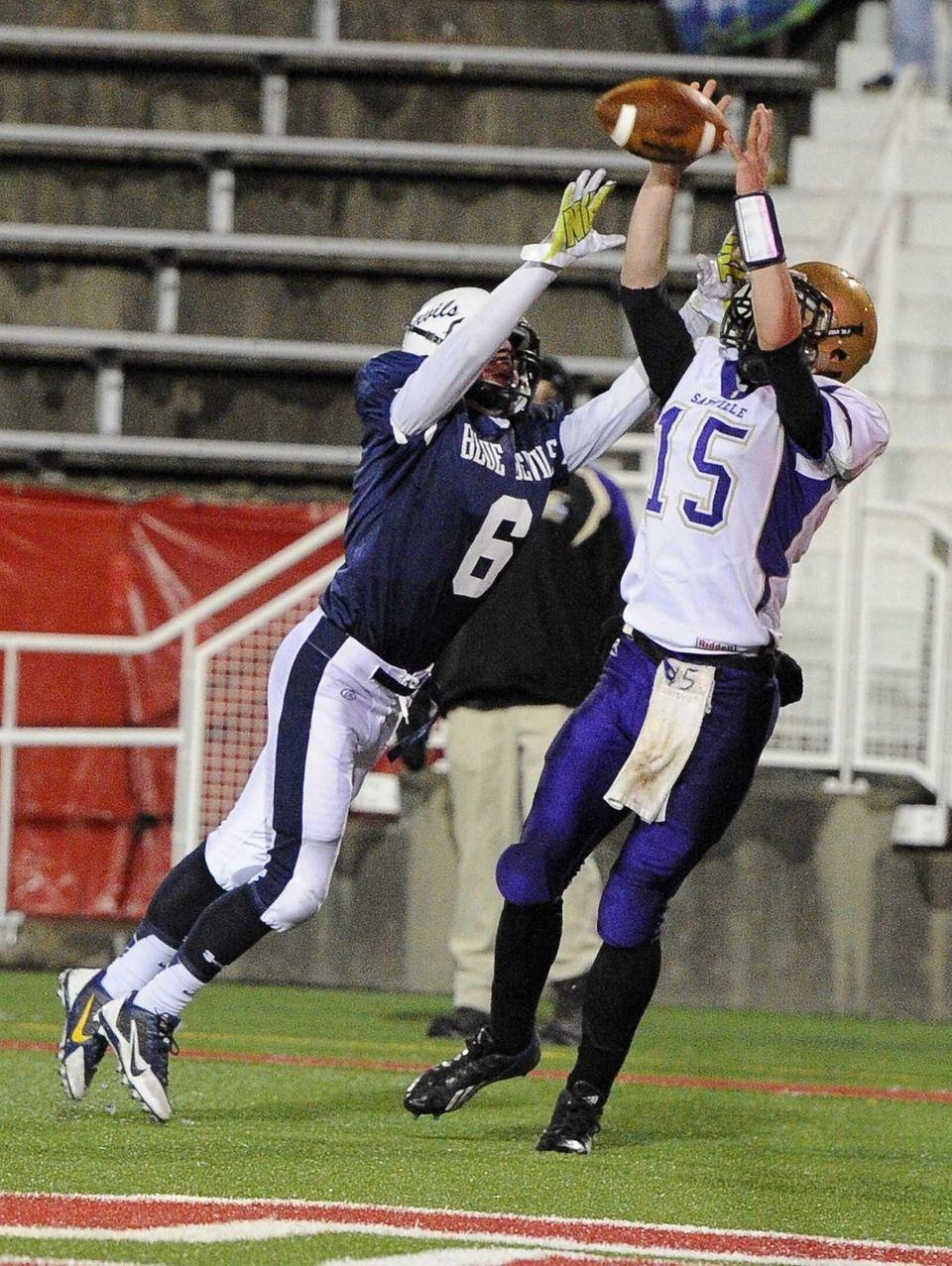 Sayville's Matt Hewson catches the pass for a