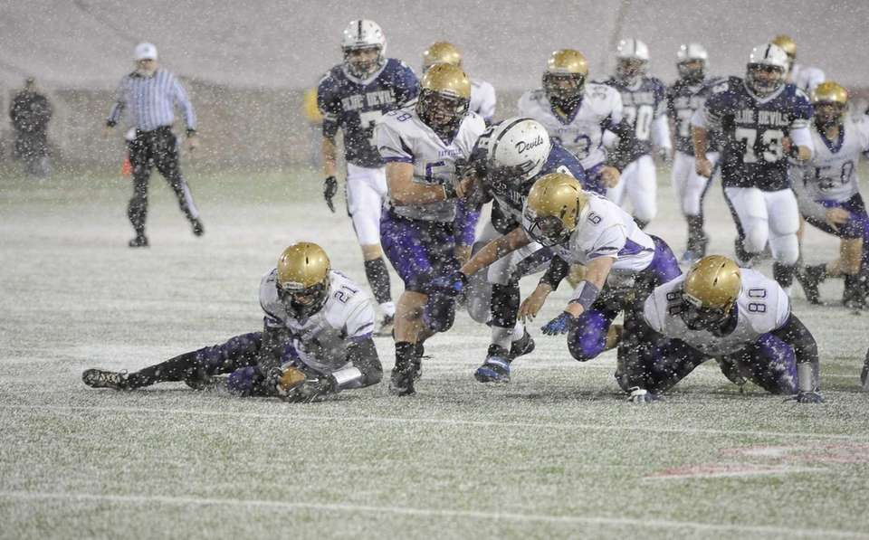 Sayville's Clay Peres recovers a fumble in the