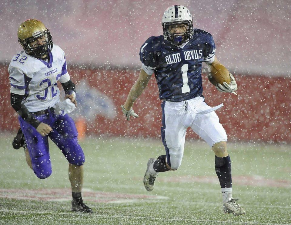 Huntington's Troy Greene runs the football ahead of