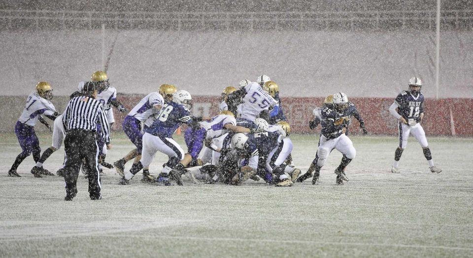 Huntington's Levar Butts runs with the football as