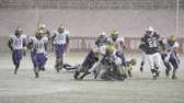 Huntington's Levar Butts fumbles the football as Sayville's