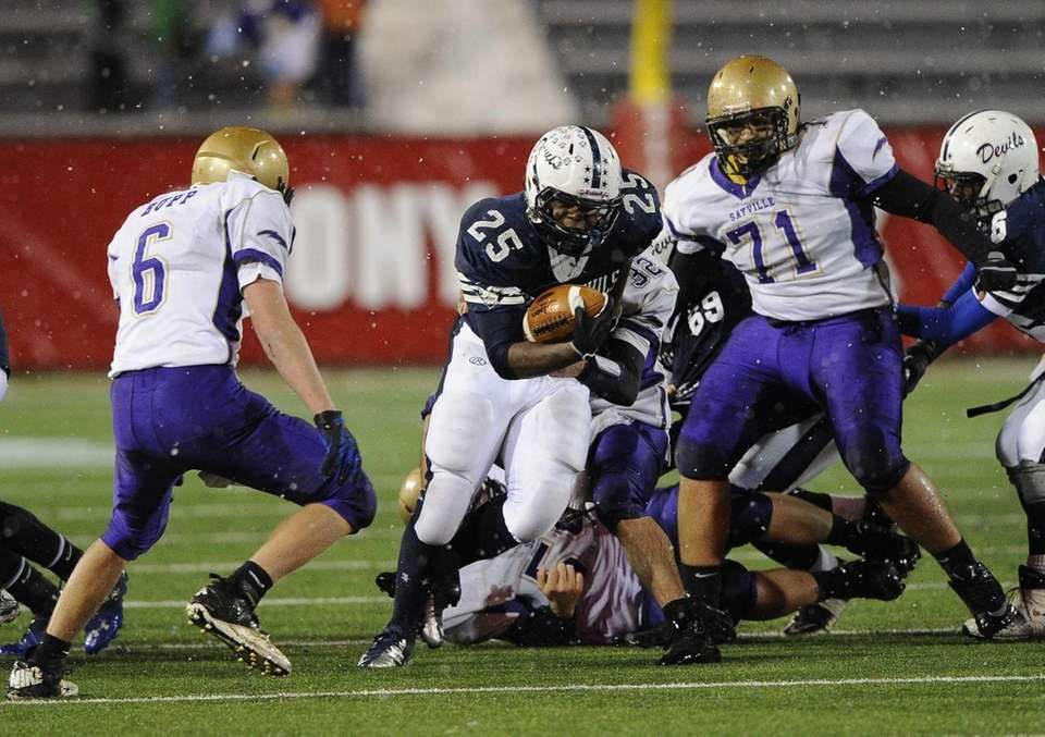Huntington's Levar Butts drives the football against Sayville